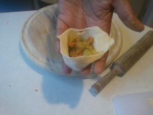 Add the filling to samosa cone